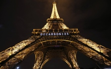 "The Eiffel Tower displays the message ""decarbonize"" within the United Nations Climate Conference on Climate Change, on 11 December 2015 in Paris."