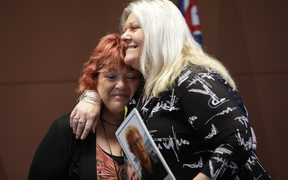 Relatives of mine victims Anna Osborne and Sonya Rockhouse embrace after the announcement of the re-entry plan.