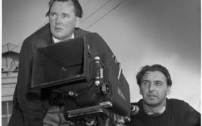 John O'Shea and Roger Mirams behind a blimped Arriflex. Probably during the shooting of one of the Kawerau productions 1954-55.