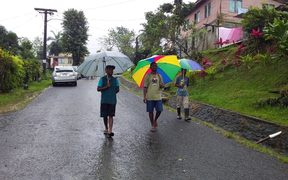 Voters donned gumboots and sheltered under umbrellas to go to cast their vote with heavy rain warning in force.