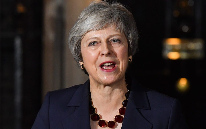 The British prime minister, Theresa May says her Cabinet has agreed the government should accept a draft treaty on Britain's departure from the European Union.