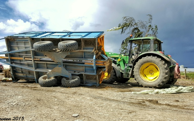 The tornado flipped over Casey Sparrow's silage wagon