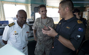 Matt Kaio (right), the New Zealand Maritime Security Operations Officer for APEC 2018, briefs Captain Phillip Polewara, the Chief of Staff of the Papua New Guinea Defence Force, and New Zealand Defence Force officer Colonel Jeremy Ramsden.