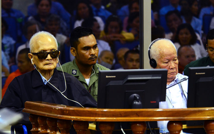 "Former Khmer Rouge leader ""Brother Number Two"" Nuon Chea (L) and former Khmer Rouge head of state Khieu Samphan (R) sitting in the courtroom at the ECCC in Phnom Penh."