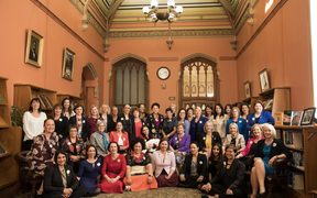 Women MPs recreate a photo of all male MPs taken in 1905 in the Reading Room of the Parliamentary Library.