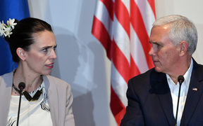 Prime Minister Jacinda Ardern and US Vice President Mike Pence speak at an electricity projects signing ceremony during the Asia-Pacific Economic Cooperation (APEC) Summit.