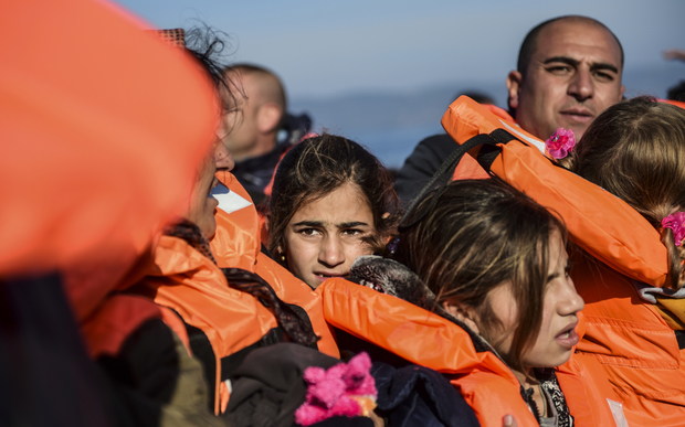 Migrants and refugees arrive on the Greek island of Lesbos after crossing the Aegean Sea from Turkey on 18 November 2015.