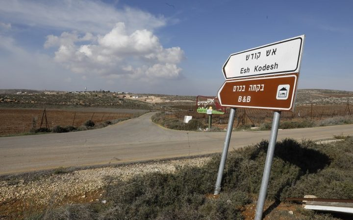 A road sign points towards an airbnb apartment located in the Esh Kodesh outpost near the Jewish settlement of Shilo and the Palestinian village of Qusra in the occupied West Bank