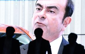 An image of Carlos Ghosn on a large screen in Tokyo