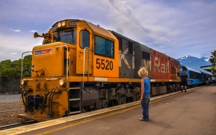 KiwiRail DXC 5520 Diesel Locomotive passenger train waiting at station in Kaikoura, New Zealand.