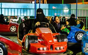 To mark the 125th anniversary of women's suffrage in New Zealand, the City Gallery presented the work of a woman artist from the last country to give women the vote, Saudi Arabia. Arwa Alneami's images are of Saudi women at an amusement park.