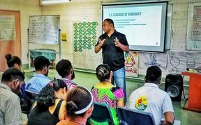 Scott Waide speaks at a Transparency International PNG youth programme.