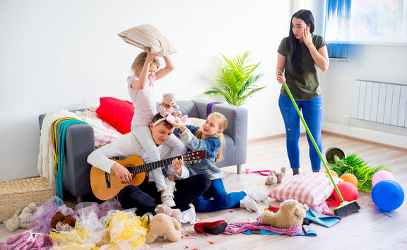 Mother is cleaning mess after her daughters played