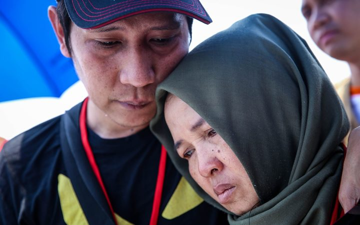 Families and colleagues of passengers and crew of Lion Air flight JT610 pray and cry on the deck of Indonesia Navy ship KRI Banda Aceh as they visit the site of the crash to pay their tribute, at the north coast of Karawang, Indonesia, on Tuesday, November 6, 2018.