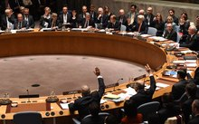 Foreign Ministers vote during a UN Security Council meeting on Syria