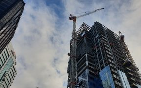 Police are speaking to a man who climbed the crane in central Auckland.