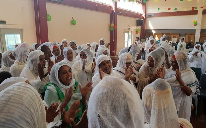 Wellington's Ethiopian community celebrating new priest.