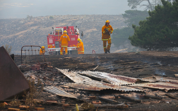 Firefighters work to contain a bushfire near Scotsburn, South of Ballarat in Victoria, Sunday, Dec 20.
