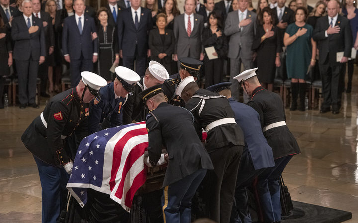 The casket containing the remains of former United States President George H.W. Bush arrives at the US Capitol. Monday, December 3, 2018.