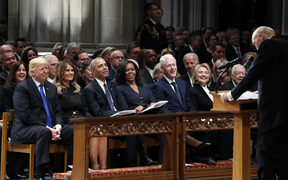 Trump, Melania Trump, Barack Obama, Michelle Obama, Bill Clinton, Hillary Clinton and Jimmy Carter listen as former Sen. Alan Simpson, R-WY., speaks during a State Funeral Funeral former US President George H.W. Bush.
