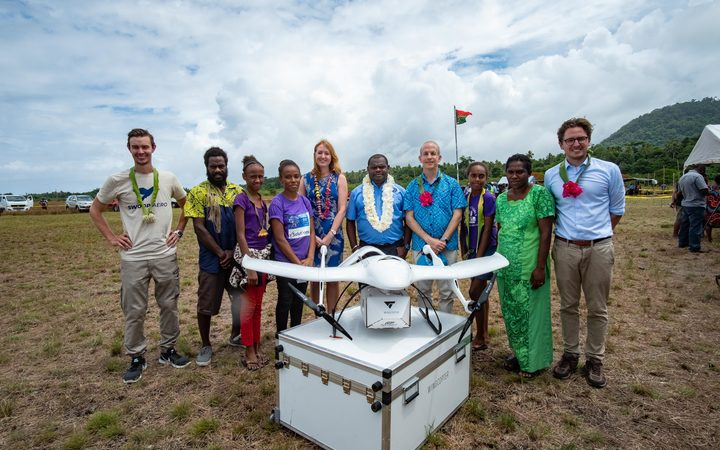 The UNICEF team with the drone on Vanuatu.