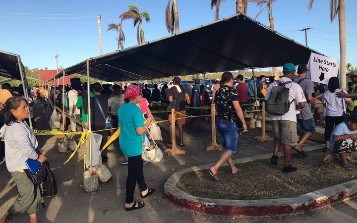 People lining up for food stamps in the CNMI after Typhoon Yutu