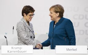 German Chancellor and Chairwoman of the Christian Democratic Union (CDU) Angela Merkel (R)greets CDU Secretary General Annegret Kramp-Karrenbauer (L) during the 31. Party Congress in Hamburg, Germany on December 7, 2018. AFP