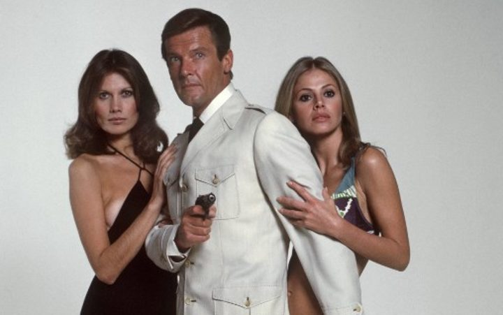 "Roger Moore (c) as James Bond and his partners Maud Adams (l) and Britt Eklund (r) in ""The Man with the Golden Gun"" in 1974."