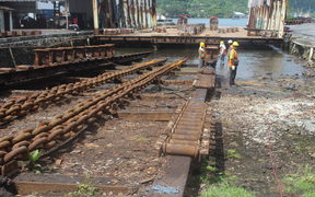 Shipyard workers conducting repairs to the 3,000 ton slipway in American Samoa
