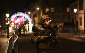 A military stands in the streets of Strasbourg, eastern France, after a shooting breakout.