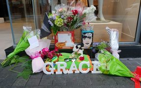 Flowers laid outside CityLife Hotel where Grace was last seen alive on 1 December.