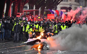 Protesters wearing yellow vests set up a barricade during a demonstration against rising costs of living they blame on high taxes in France.