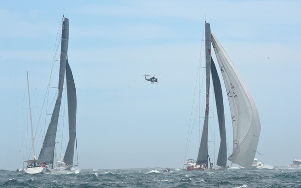 Yachts Wild Oats XI (R) and Ragamuffin 100 at the start of the 71st Rolex Sydney to Hobart yacht race on Sydney Harbour in Sydney on Saturday, Dec. 26, 2015.