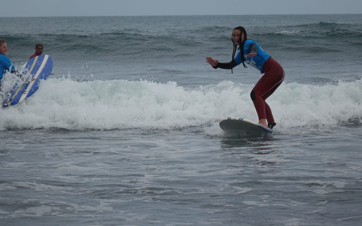 Otorohanga College student Tasmin White enjoyed the surfing experience at Fitzroy beach.