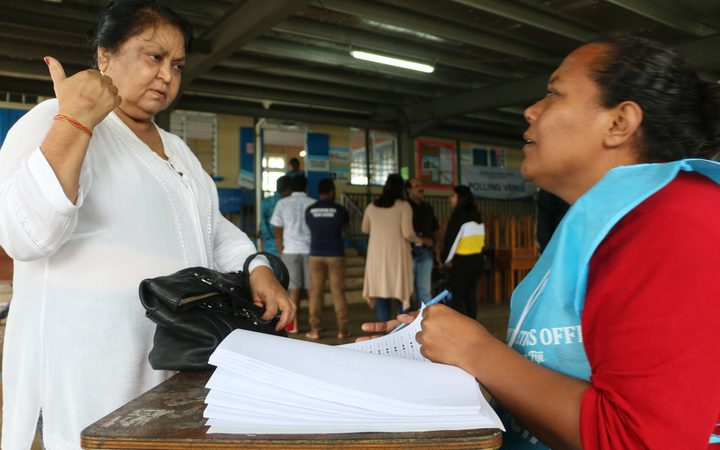 A voter in Fiji seeking confirmation about where to vote