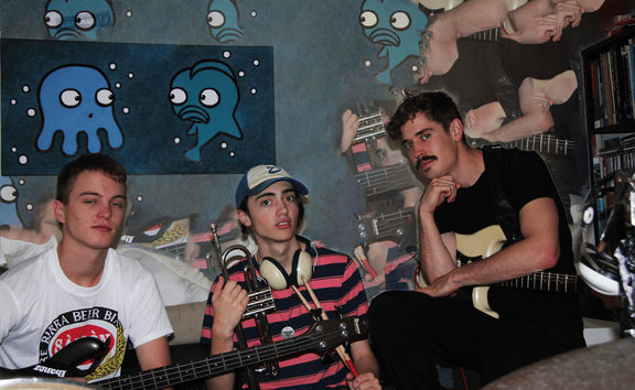 Josh Rundle (bass), Cameron McCurdy (vocals, drums, trumpet), Mitchell Baber (vocals, guitar)