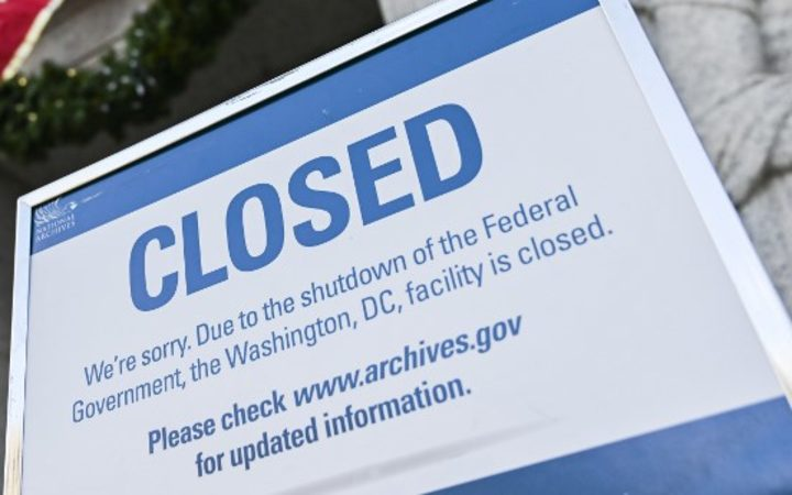 A sign is displayed at the National Archives building that is closed because of a US government shutdown in Washington, DC, on December 22, 2018. - AFP