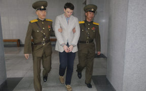 American student Otto Frederick Warmbier (centre) arrives at a court for his trial in Pyongyang.