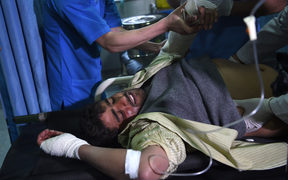 A wounded Afghan man receives treatments at a hospital after a car bomb attack in Kabul.