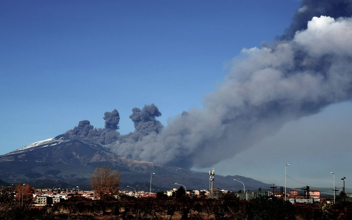 Smoke rises over the city of Catania during an eruption of the Mount Etna, one of the most active volcanoes in the world on December 24, 2018.