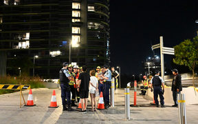 "Australian police evacuated thousands of people in west Sydney late Christmas Eve, after residents reported hearing a ""loud crack"" from a 38-storey building."