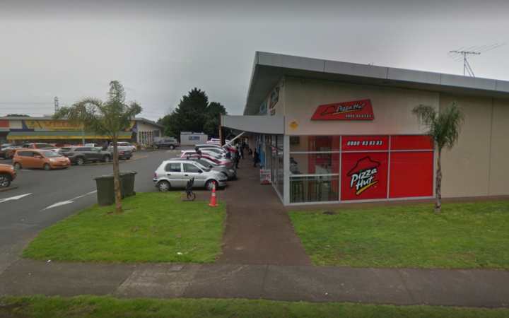 A woman was stabbed outside the Bairds Road Pizza Hut.