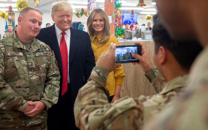 President Donald Trump pays unannounced visit to United States troops in Iraq