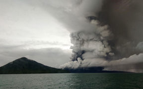 Anak (Child) Krakatoa volcano erupting, as seen from a ship on the Sunda Straits on 26 December.