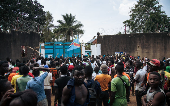 Protesters outside the Ebola response headquarter in Beni during a demonstration against the postponement of elections in the Beni territory and the city of Butembo.