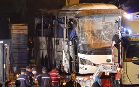This picture taken on December 28, 2018 shows a tourist bus which was attacked being towed away from the scene, in Giza province south of the Egyptian capital Cairo.
