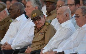 Raul Castro and President Miguel Diaz-Canel (second from left) take part in the celebration of the 60th anniversary of the Cuban revolution at the Santa Ifigenia Cemetery in Santiago de Cuba.