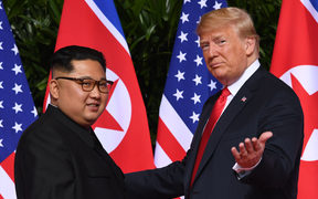 US President Donald Trump gestures as he meets with North Korea's leader Kim Jong Un at the start of their historic US-North Korea summit in 2018.