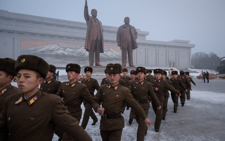 Korean People's Army soldiers leave after bowing before the statues of late North Korean leaders Kim Il Sung and Kim Jong Il during National Memorial Day in Pyongyang on 17 December, 2018.