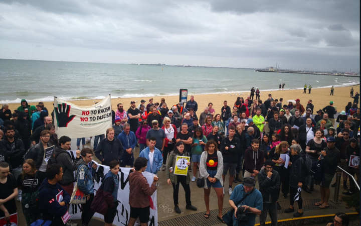 Counter protesters on St Kilda Beach.